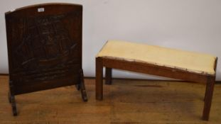 An Arts and Craft style oak stool, 83 cm wide, and a carved oak firescreen, 50 cm wide (2)
