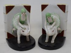 A pair of modern bookends, in the form of women riding pigs, 15 cm high This item is 20th/21st