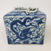 A Chinese blue and white square vase, with applied dragons, six character mark to base, 12 cm