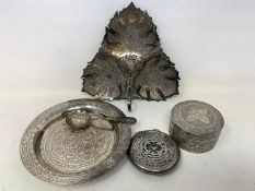 A Malaysian style silver coloured metal leaf shaped dish, 19 cm wide, a similar silver coloured