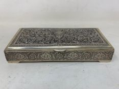 A Persian silver coloured metal table cigarette box, decorated birds, flowers and foliage, 16 cm
