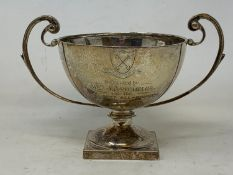 A silver two-handle trophy cup, inscribed and dated 1949, London 1924, 7.7 ozt, 12.5 cm high