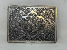 A Persian silver coloured metal cigarette case, decorated birds, flowers and foliage, 10.5 cm wide