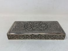 A Persian silver coloured metal table cigarette box, decorated birds, flowers and foliage, 16.5 cm