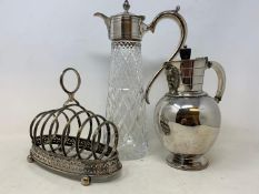 A silver cream jug, marks rubbed, 3.5 ozt, a silver part dressing table set and assorted silver