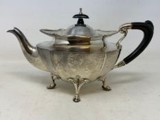 A silver teapot, of shaped oval form, marks rubbed, probably Birmingham 1920, 19.1 ozt (all in),