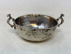 A Continental silver coloured metal two handle bowl, of hammered form, 13 cm wide RB Report Silghtly