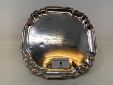 An 18th century style silver waiter, of shaped square form, inscribed and dated 1956, Britannia