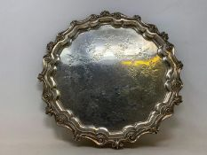 An 18th century style silver salver, engraved foliage and swags, marks rubbed, 18.8 ozt, 28.5 cm