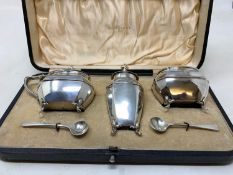 A silver three piece condiment set, Walker & Hall, Sheffield, 1912, boxed From a deceased estate,
