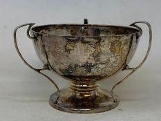 An Arts & Crafts style Silver three-handle trophy, Birmingham 1912, 5.6 ozt, 10.5 cm high Worn thin,