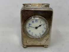 An Edward VII travelling clock, the 3.5 cm dial with Arabic numerals, in a silver case, inscribed