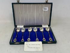 A set of six Egyptian silver coloured metal teaspoons, with camel and crescent finials, cased