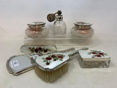 A silver and enamel seven piece dressing table set, decorated roses, Birmingham 1959 Report by RB