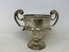 A silver two handle trophy cup, London 1906, 7.7 ozt, 12 cm high