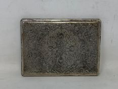 A Persian silver coloured metal cigarette case, decorated birds, flowers and foliage, 11.5 cm wide