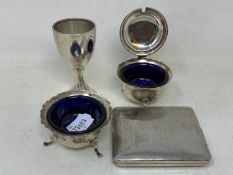 A silver cigarette case, two silver condiments, and a small silver trophy cup, 8.8 ozt