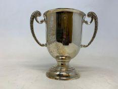 A silver two handle trophy cup, Birmingham 1934, 9.3 ozt, 6.5 cm high