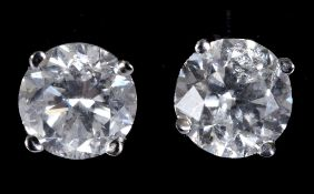 A pair of white gold and diamond stud earrings, approx. 1.41ct