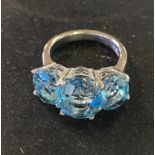 A silver and three stone blue topaz dress ring, approx. ring size N½ Report by RB Modern