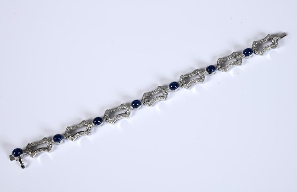 A white coloured metal fancy link diamond and cabochon sapphire bracelet, 17 cm, in a Mappin & - Image 2 of 2