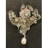 An Art Nouveau style silver pendant/brooch, with opals, rubies and marcasite