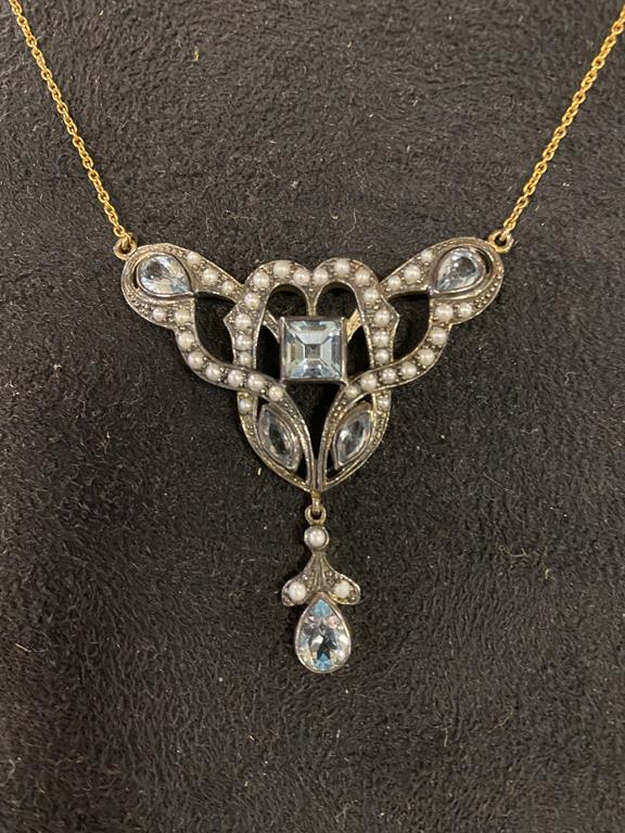 A modern Art Nouveau style pendant necklace, inset with white and blue stones Report by JS Note: