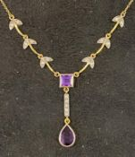 A modern gold plated Art Nouveau style pendant necklace inset with purple and white stones Report by