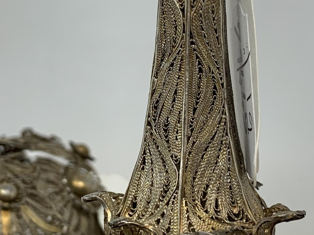 An Indian pair of silver coloured metal filigree work rosewater sprinklers, 34 cm high, and three - Image 3 of 11
