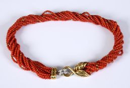 A multi-strand coral bead necklace, with an 18ct gold and diamond clasp