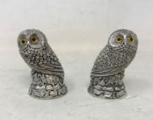 A pair of modern silver plated owl form salt and pepper pots, 5 cm high Report by JS Note: this is