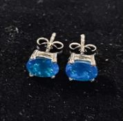 A pair of oval apatite stud earrings, set in silver