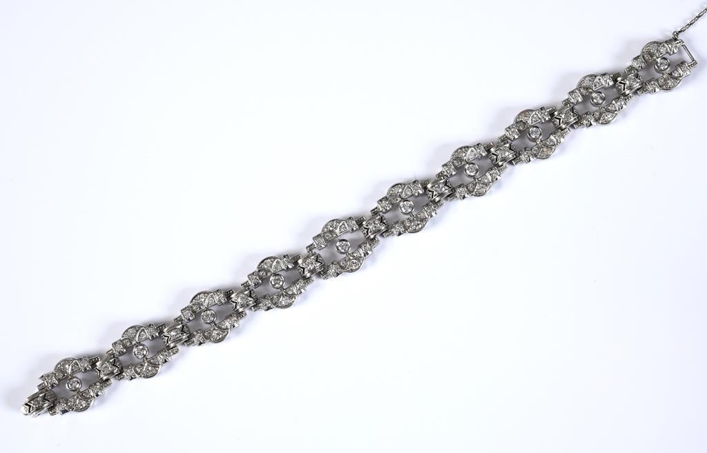 An Art Deco style white coloured metal and diamond fancy link bracelet, 16.5 cm