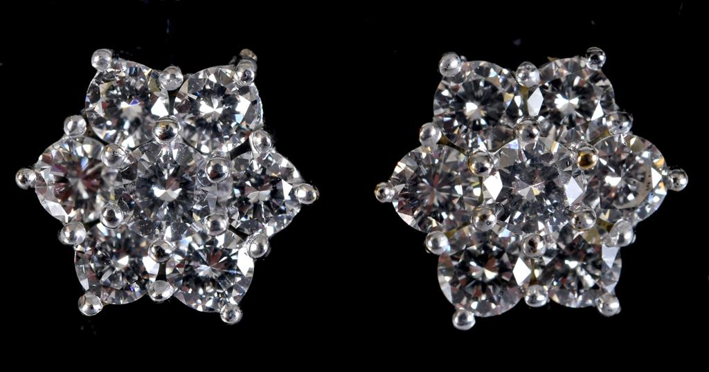 A pair of 18ct white gold and diamond flowerhead earrings RB report Estimated diamonds 1.61ct