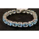 A modern silver coloured metal and topaz bracelet Report by JS Note: this is 20th/21st century