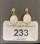 A modern pair of of yellow metal and opal drop earrings Report by JS Note: this is 20th/21st century