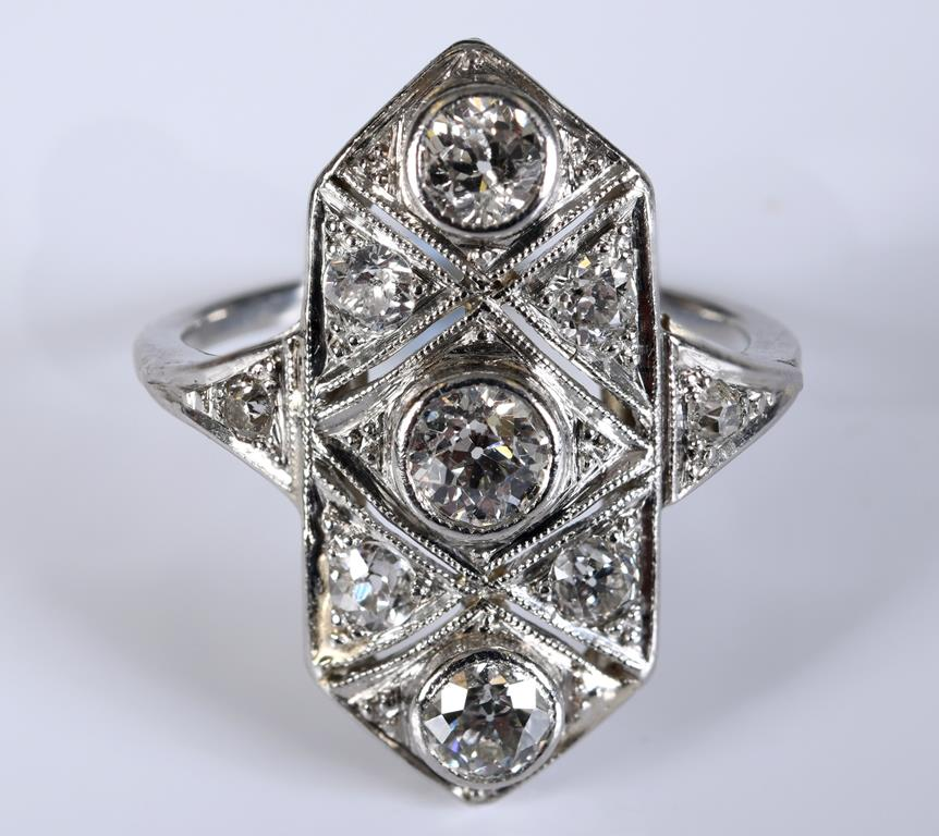 An Art Deco style white coloured metal and diamond panel type ring, approx. ring size J½ Report by