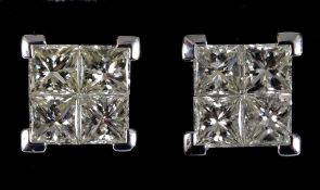 A pair of 18ct gold and invisible set princess cut diamond stud earrings, with screw backs, the
