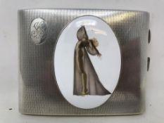 A silver cigarette case, later applied a plaque, London 1940, 11 cm wide