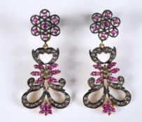 A pair of ruby and diamond drop earrings