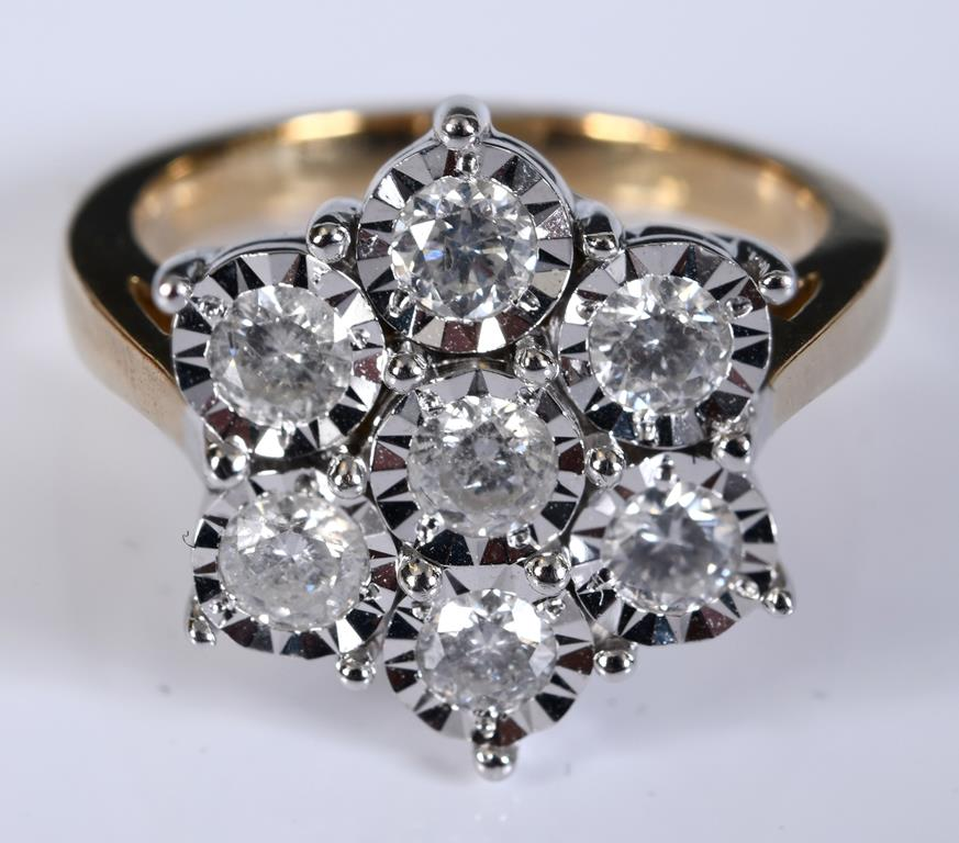 A 9ct gold and diamond flowerhead cluster ring, approx. ring size N½ Report by RB Modern Illusion