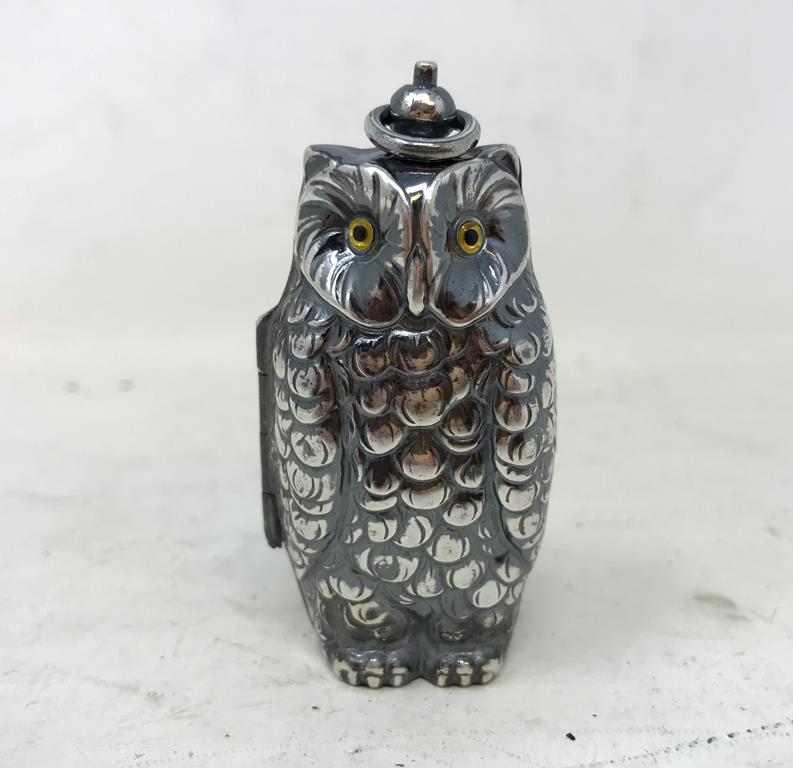 A novelty silver plated owl double sovereign case Report by RB Modern