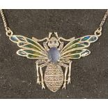 A modern silver coloured metal bee necklace, with enamel wings Report by JS Note: this is 20th/