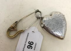 A modern silver coloured metal novelty vesta, in the form of a heart, and a pin (2) Report by JS