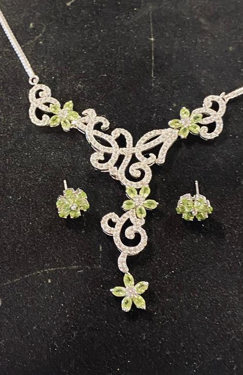 A silver and peridot necklace, with matching earrings Report by RB Modern