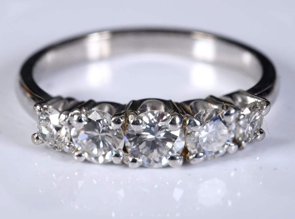 A white coloured metal and five stone diamond half hoop ring, approx. ring size N, diamonds