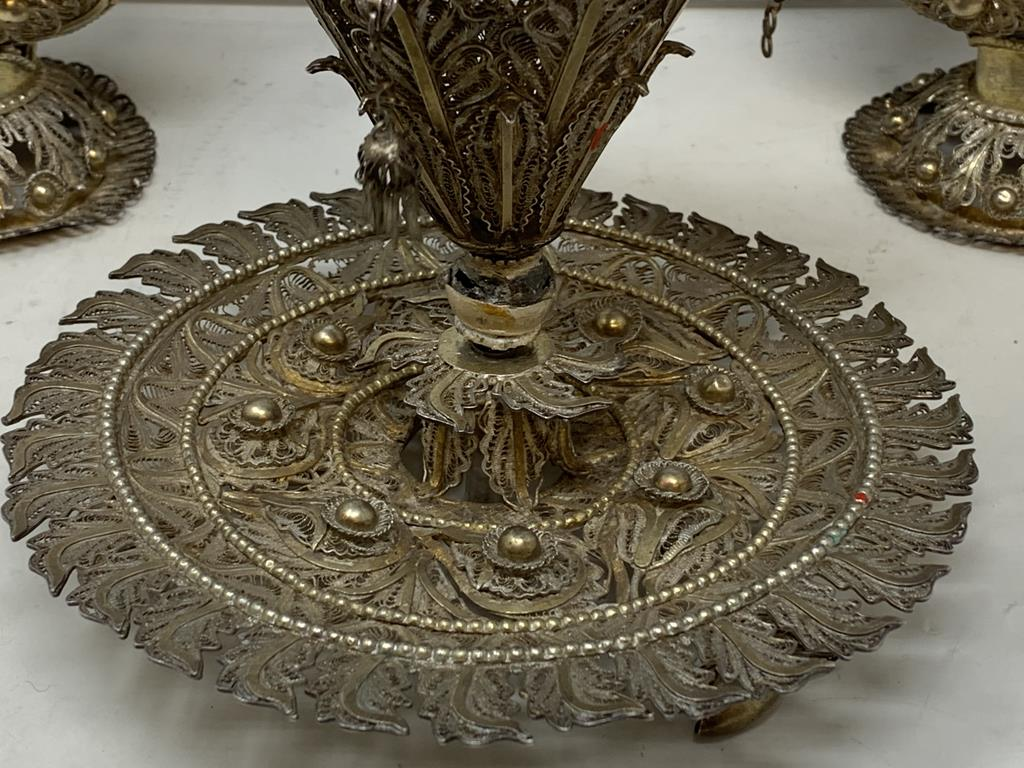 An Indian pair of silver coloured metal filigree work rosewater sprinklers, 34 cm high, and three - Image 5 of 11