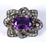 An amethyst and diamond brooch, the central amethyst weighing approx. 8.73ct within a framework of