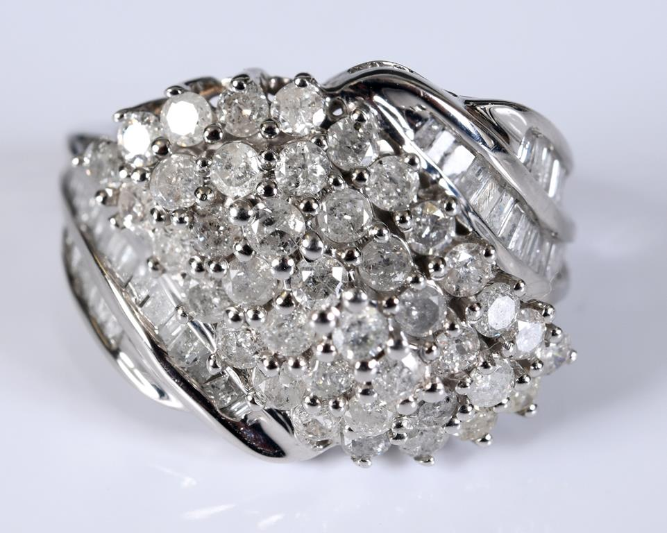 A 9ct white gold and diamond cluster ring, the diamonds approx. 2.04ct, approx. ring size J