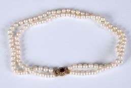 A two row graduated cultured pearl necklace, with a 9ct gold clasp
